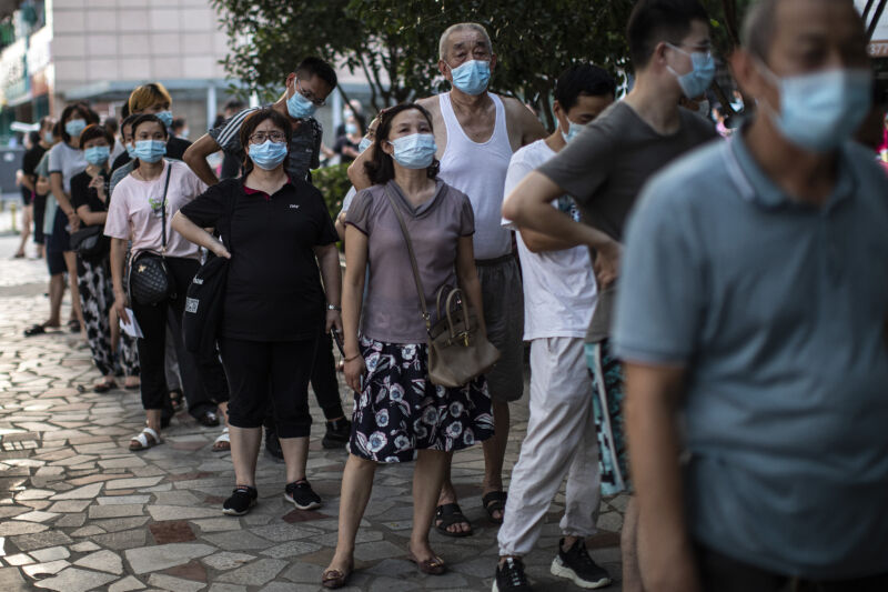 Residents line up for nucleic acid testing of COVID-19 on August 3, 2021, in Wuhan, Hubei Province, China.