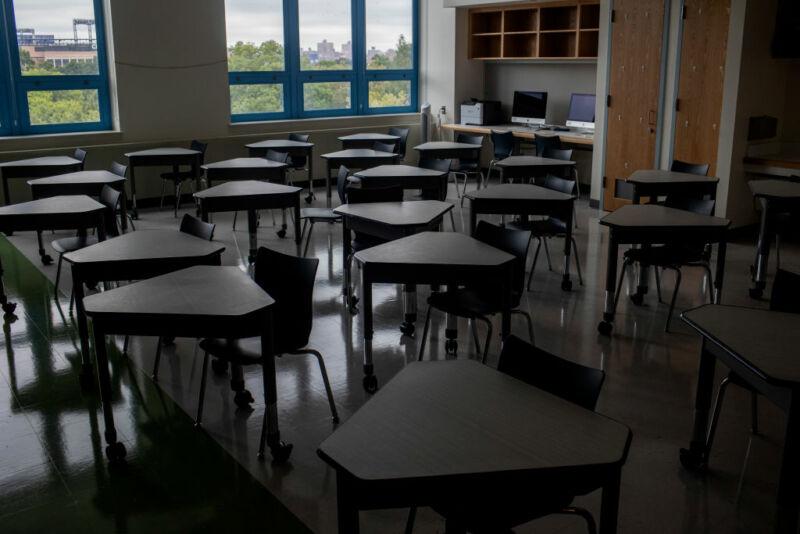 Image of a darkened, empty classroom.