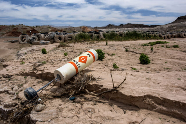 A buoy and truck tires sit on what used to be the bottom of Lake Mead at the abandoned Echo Bay Marina in Overton, Nevada.