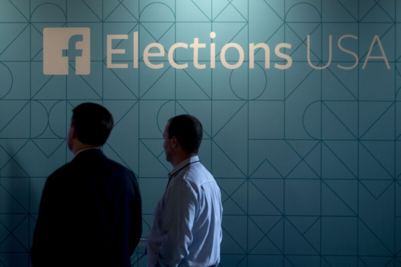 Guests stand next to a Facebook Elections USA sign in the Facebook Lounge ahead of the first Republican presidential debate at Quicken Loans Arena in Cleveland, Ohio, U.S., on Thursday, Aug. 6, 2015.
