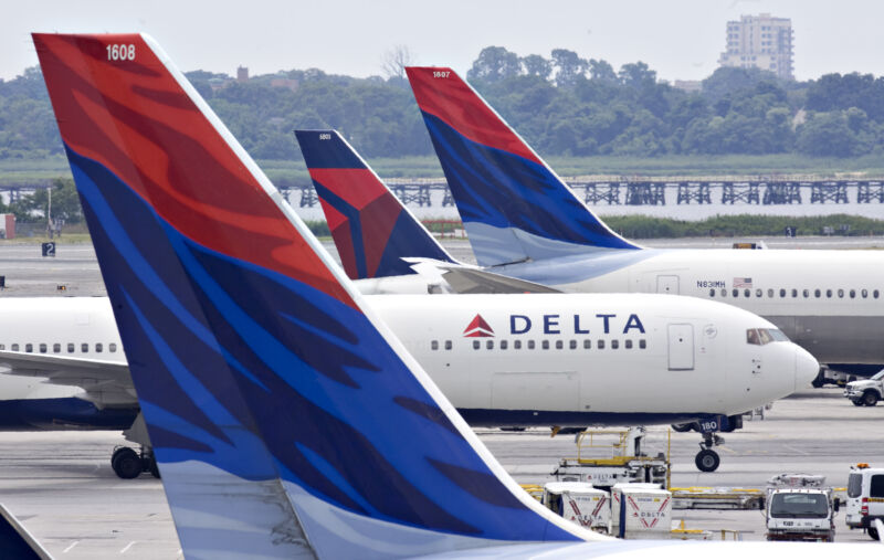 Delta Air Lines plane taxis toward a gate between other Delta planes at John F. Kennedy International Airport in New York on Monday, July 20, 2009.