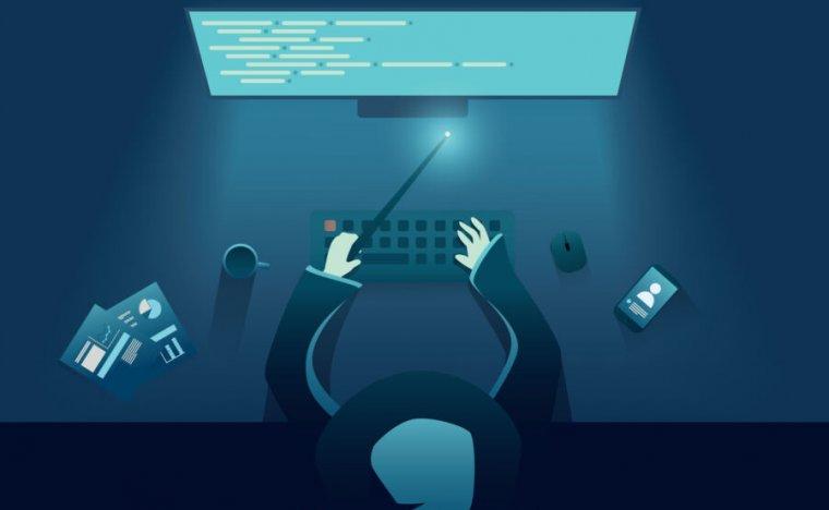 IT programmer as genius or wizard sitting behind computer.