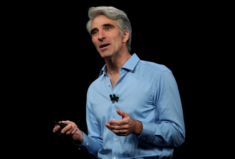 Apple executive Craig Federighi speaking on stage at an Apple conference in 2018.