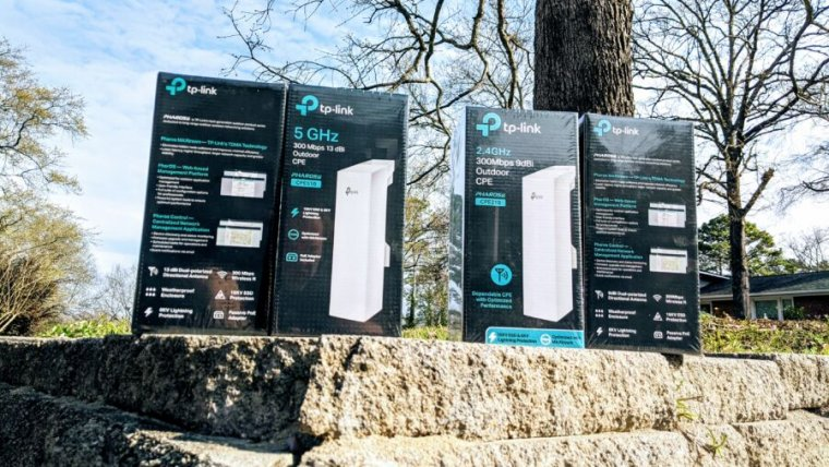 We tested these TP-Link outdoor Wi-Fi bridges—both 2.4GHz and 5GHz versions—across 80 meters of partially wooded terrain, with great success.