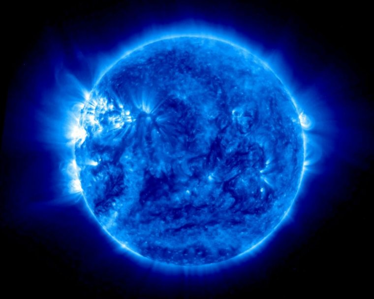 A stylized photograph of the Sun renders it blue.