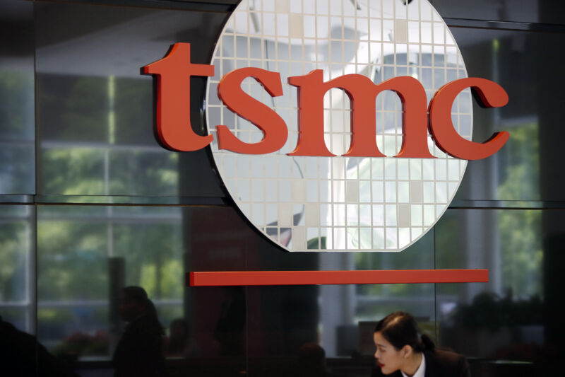 Signage for Taiwan Semiconductor Manufacturing Co. (TSMC) is displayed inside the company's headquarters in Hsinchu, Taiwan.