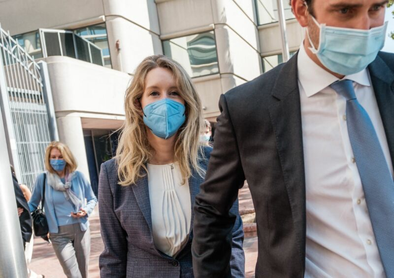 Elizabeth Holmes, founder and former CEO of blood-testing and life sciences company Theranos, leaves the courthouse with her husband, Billy Evans, after the first day of her fraud trial in San Jose, California, on September 8, 2021.