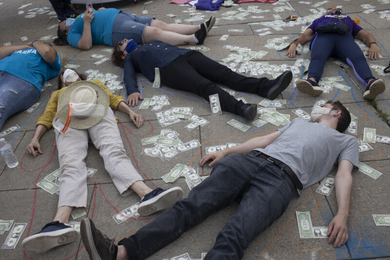 Friends and family members of people who have died during the opioid epidemic protest against a bankruptcy deal with Purdue Pharmaceuticals that allows the Sackler family to avoid criminal prosecution and to keep billions of dollars in private wealth, on August 9, 2021, outside the Federal courthouse in White Plains, New York.