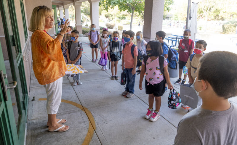 A second-grade teacher talks to her class during the first day of school at Tustin Ranch Elementary School in Tustin, CA on Wednesday, August 11, 2021.