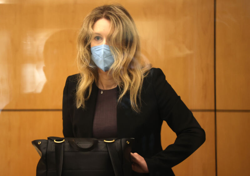 Former Theranos founder and CEO Elizabeth Holmes goes through security after arriving for court at the Robert F. Peckham Federal Building September 17, 2021 in San Jose, California. Holmes is facing charges of conspiracy and wire fraud for allegedly engaging in a multimillion-dollar scheme to defraud investors with the Theranos blood testing lab services.
