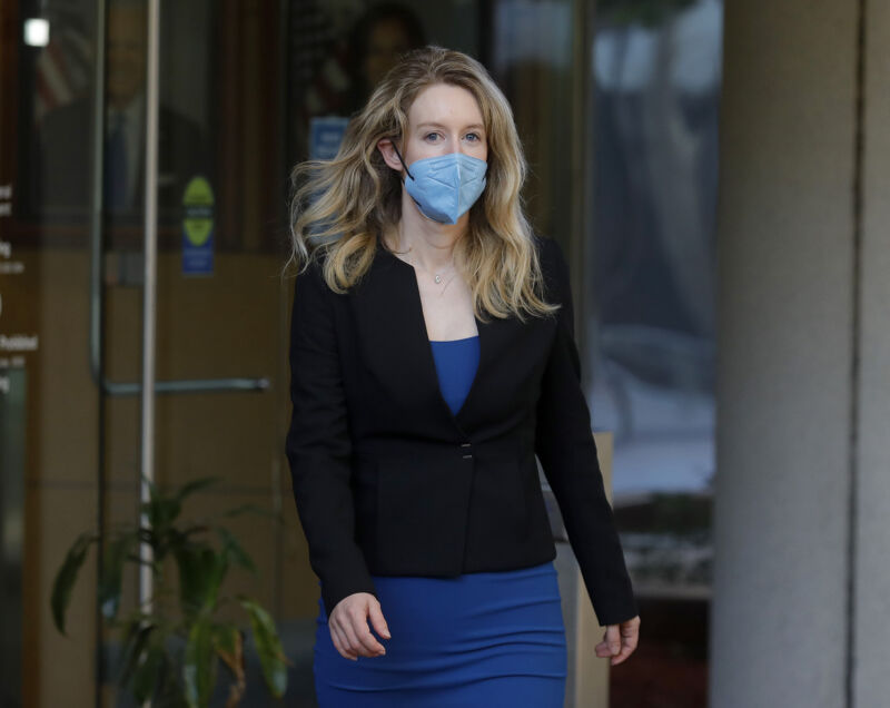 Theranos founder Elizabeth Holmes leaves the Robert F. Peckham Federal Building and US Courthouse in San Jose, Calif., on Wednesday, Sept. 22, 2021. Holmes is charged with two counts of conspiracy to commit wire fraud and nine counts of wire fraud and could face up to 20 years in prison if convicted.