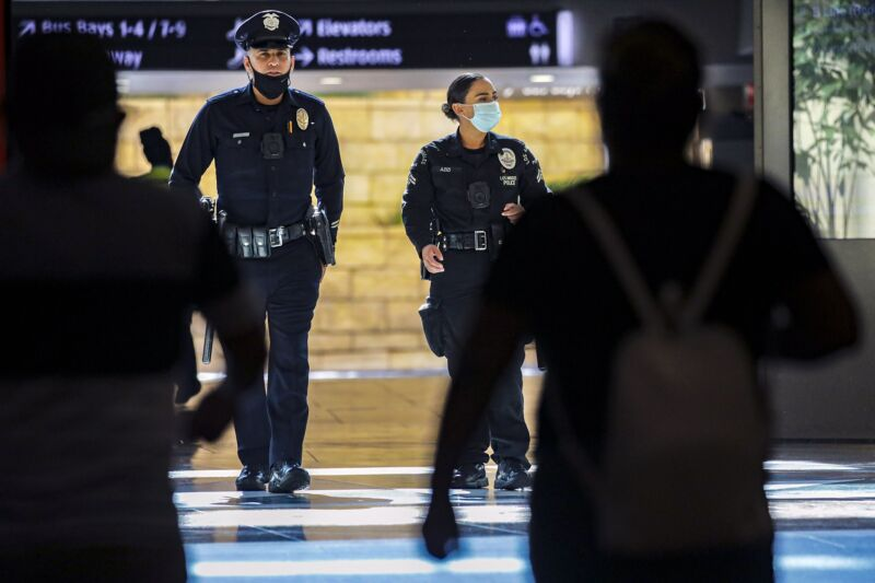 Two Los Angeles Police Department officers walking through Union Station.