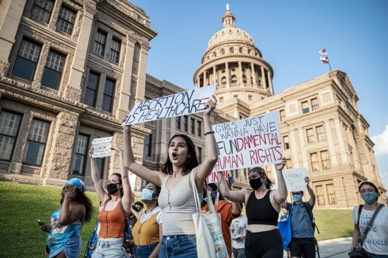 Pro-choice protesters march in Texas, carrying signs that say