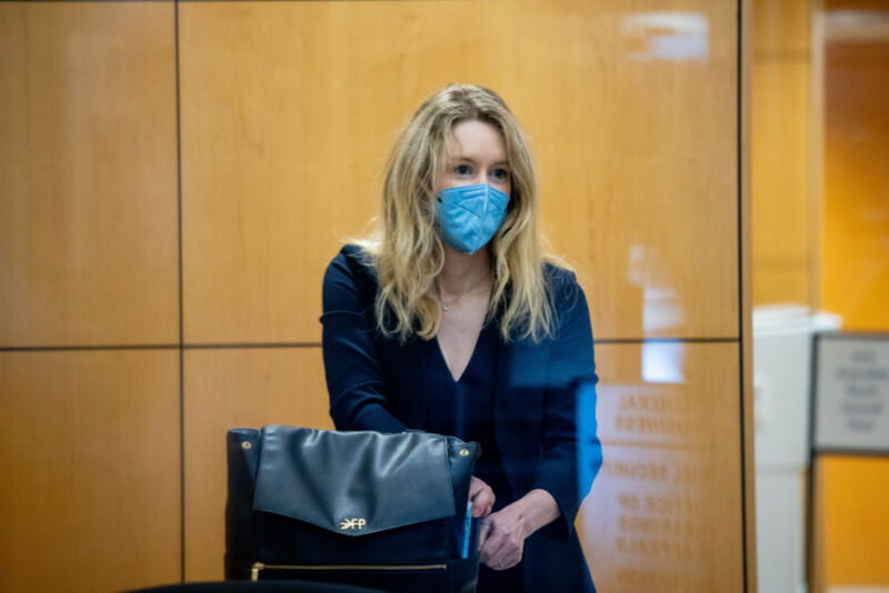 Technology Theranos founder Elizabeth Holmes collects her belongings after going through security at the Robert F. Peckham Federal Building with her defense team on August 31, 2021, in San Jose, California.