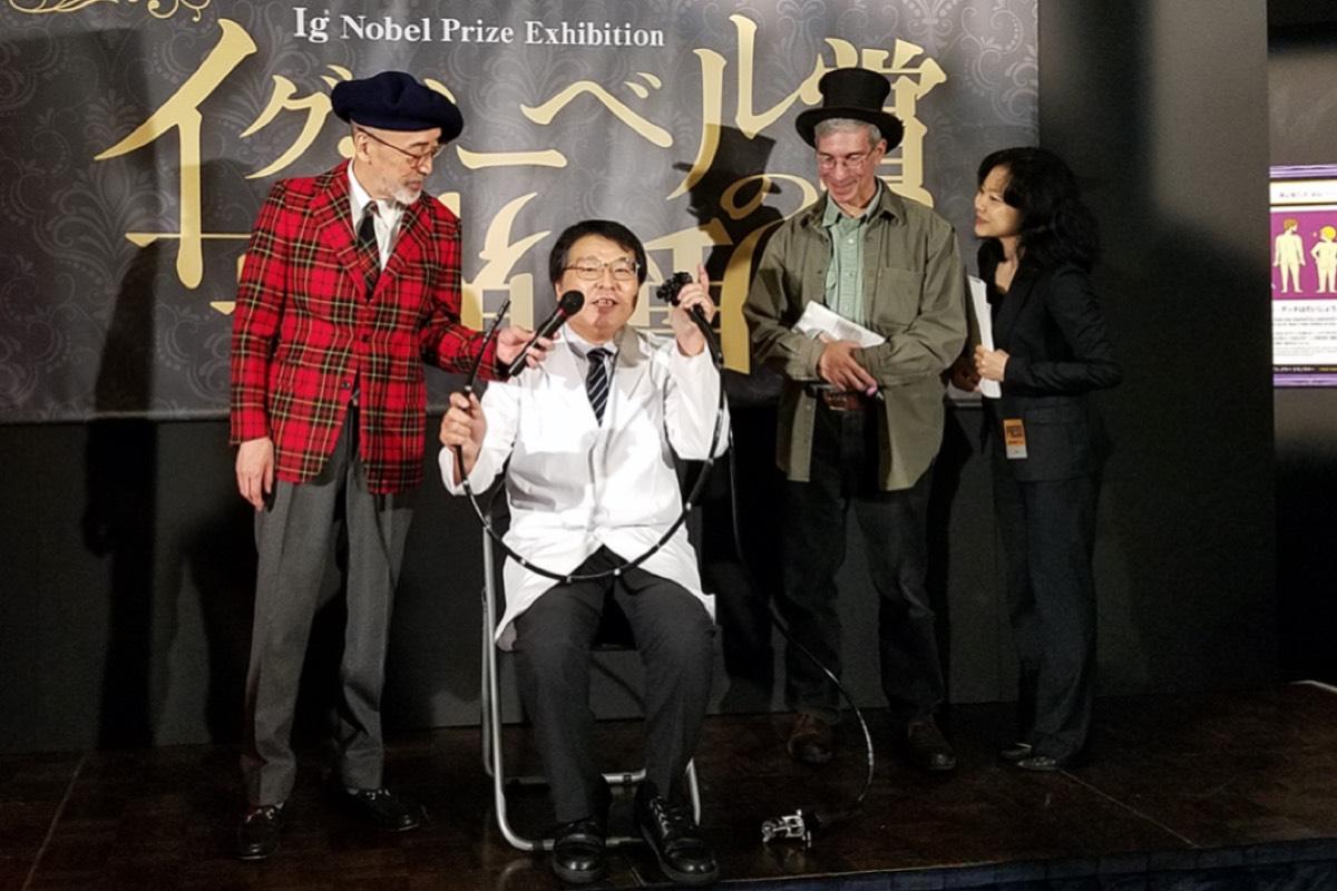 Akira Horiuchi (center) won the 2018 Ig Nobel Medical Education Prize for his do-it-yourself colonoscopy tube.