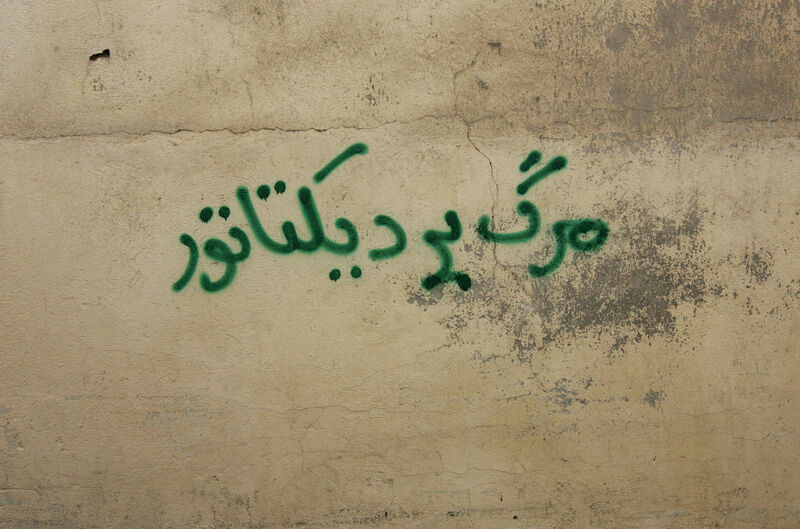 """An anti-government graffiti that reads in Farsi """"Death to the dictator"""" is sprayed at a wall north of Tehran on September 30, 2009."""