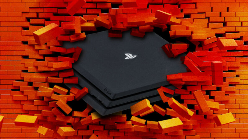 A video game console smashes through a brick wall.