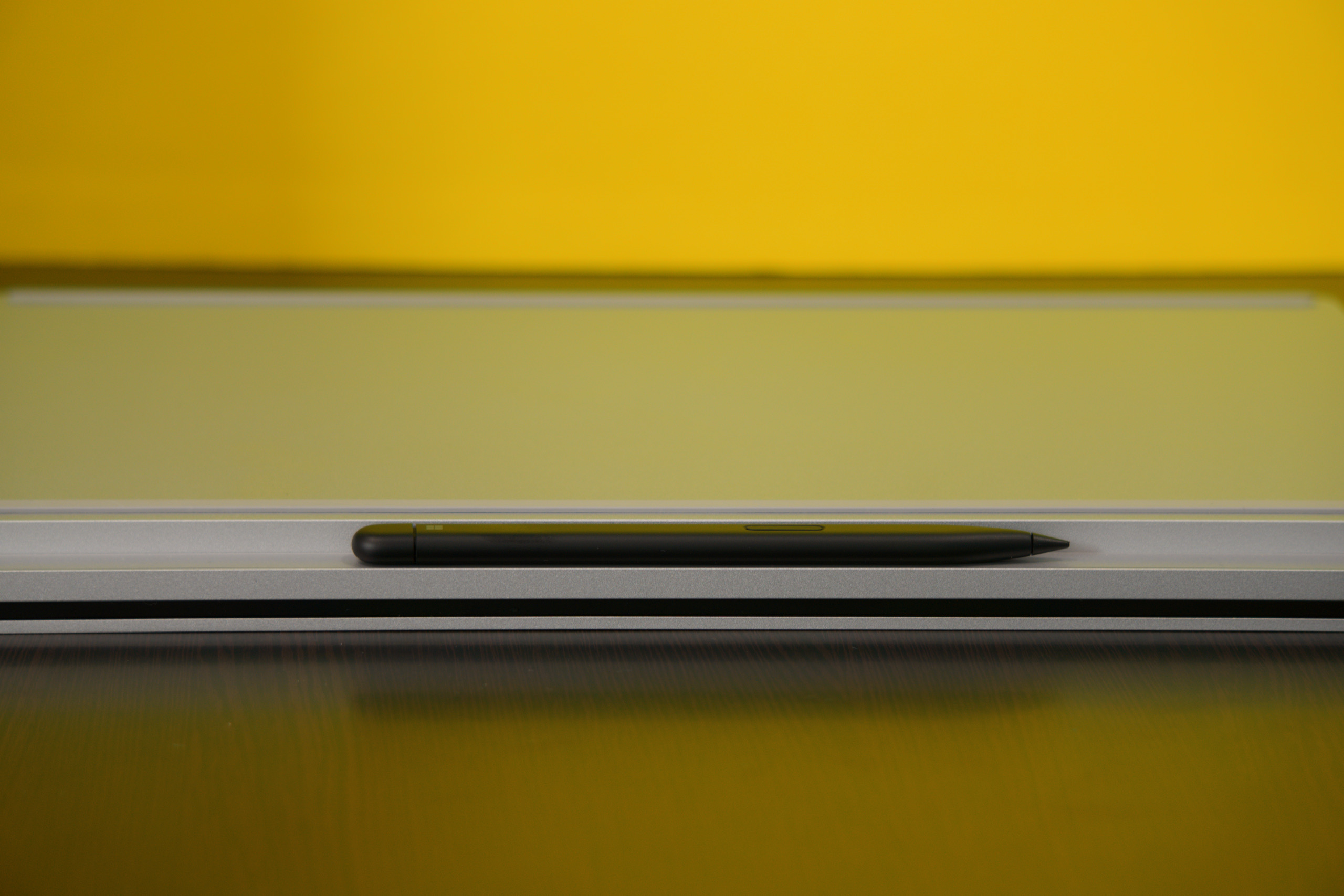 The Surface Slim Pen 2 attaches and charges under the lip on the front of the laptop.