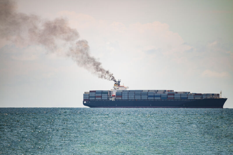 A container ship sails off the coast of Thailand.