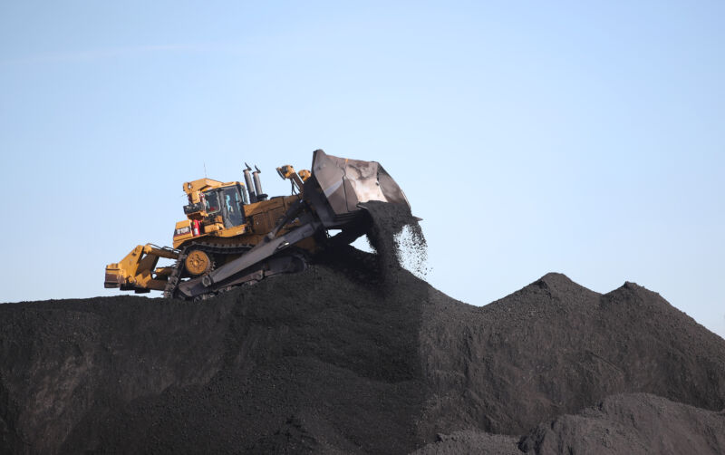 Heavy equipment moves coal into piles at PacifiCorp's Hunter coal-fired power plant outside of Castle Dale, Utah.