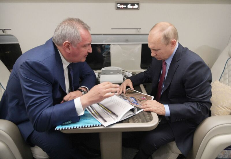 Russian President Vladimir Putin speaks with head of Russian space agency Roscosmos Dmitry Rogozin during a flight to the Vostochny cosmodrome, on September 4, 2021.