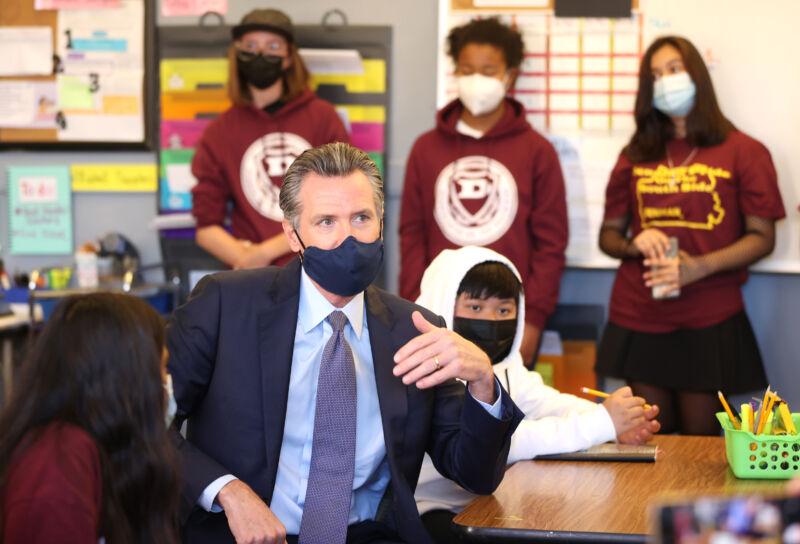 California Gov. Gavin Newsom talks with 7th grade students at James Denman Middle School on October 01, 2021 in San Francisco, California.
