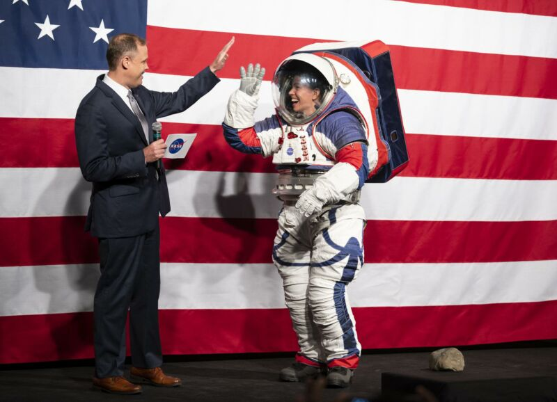 NASA Administrator Jim Bridenstine high-fives Kristine Davis, a spacesuit engineer at NASA's Johnson Space Center, wearing a ground prototype of NASA's new Exploration Extravehicular Mobility Unit (xEMU) in 2019.