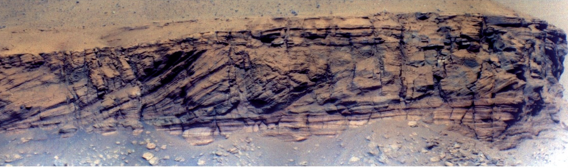 A closeup of Kodiak showing the flat/sloped/flat pattern of deposits that resulted from the growth of a delta within the crater lake.