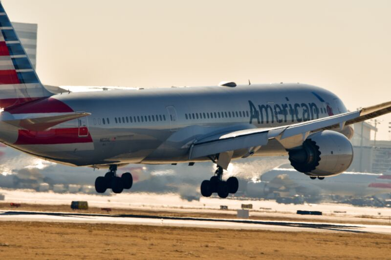 An American Airlines plane landing on a runway at Dallas Fort Worth International Airport.