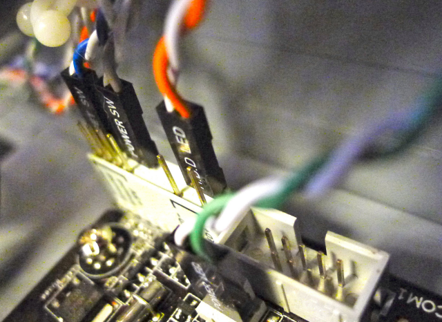 The case's buttons plugged into a dongle that came with the motherboard. Matching labels here proved effective.