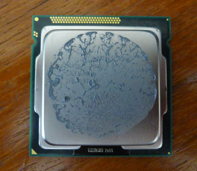 The Core i5 CPU. The gold triangle goes in the bottom left corner of the socket, not the gold circle. Hopefully you learned yourself some shapes in the past.
