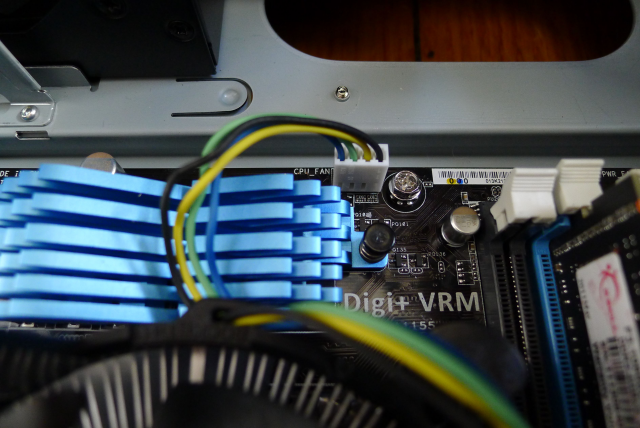 The CPU cooler has a 4-pin connector that plugs into the top of the motherboard.