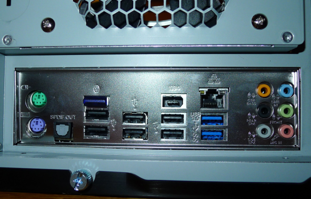 The I/O ports on the motherboard press against the I/O plate that came with the motherboard.