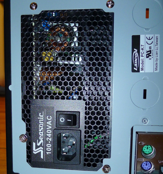 The power supply, slid into place and secured with screws, supplies all the juice to the rest of the computer.