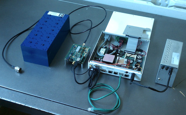 From left to right: UHF-band filter, frequency translator, PC motherboard and WiFi card, power supply