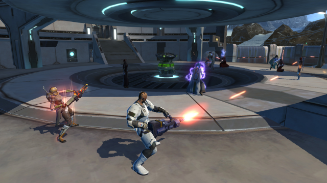 Players fighting for a turret as a Twi'lek player stands stunned next to it.