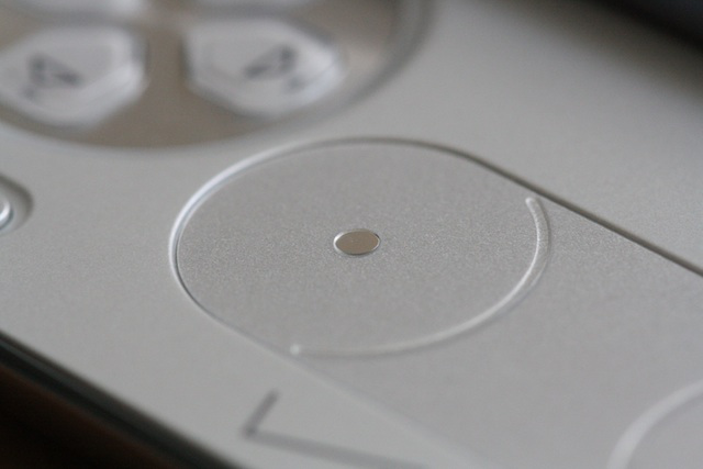 One of the Xperia Play's analog pads, with a small glassy sensor standing in for the analog stick.