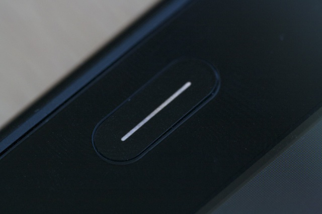 A closeup of the TouchPad's home button.