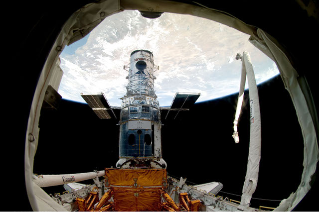 The Hubble Space Telescope as seen from the shuttle Atlantis during the fifth and final servicing mission.
