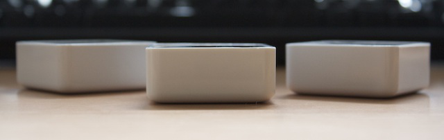 Sifteo cubes from the side, about half an inch high.