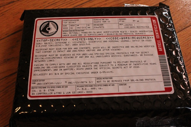 MOAR SEKRITS. The warnings on the included journal pointing out the top secret nature of the contents. The other side is sealed with a sticker sporting the ONI logo. Again, the detail is wonderful.