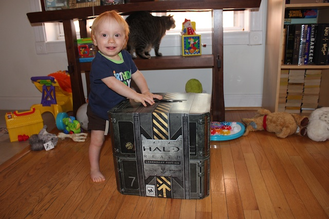 It's hard to get a sense for how large the package is from the pictures. For scale, I included a miniature human. When the package first arrived I thought it was a system, not the game. The box is heavy cardboard, and is sealed on both sides with tape.