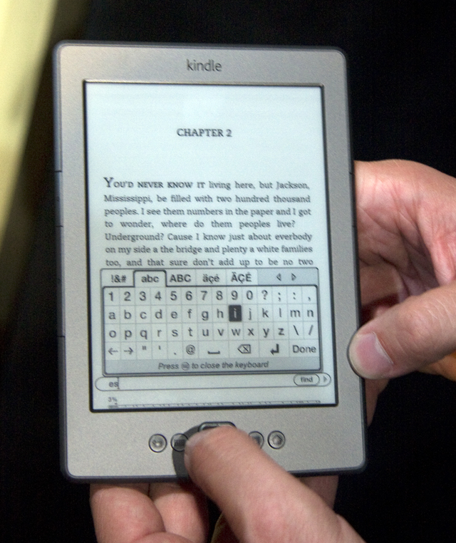 The touch-free Kindle requires working a rocker switch to navigate among virtual keys.