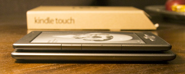 The page turn buttons on the side of the Kindle are a thing of the past with the Touch (bottom).