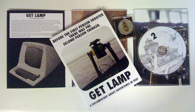 The contents of the <em>Get Lamp</em> box, including commemorative coin.
