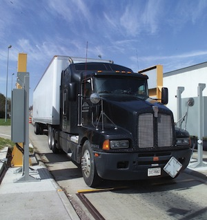Truck weigh-and-inspection station with radiation portal monitor.