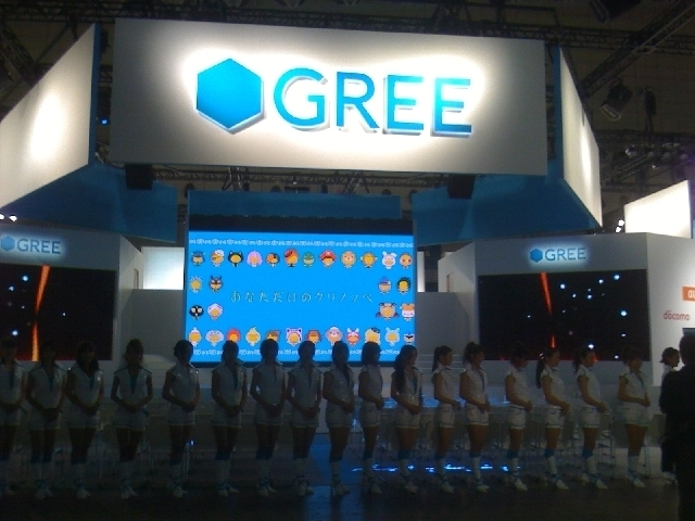 The army of GREE booth girls, manning the massive GREE booth.