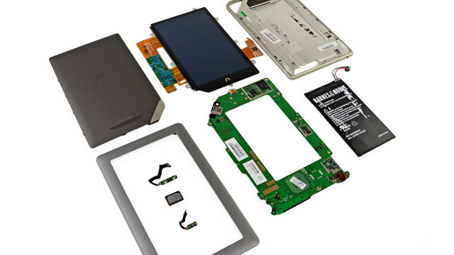 Barnes & Noble's Nook Tablet splayed and naked on iFixit's operating table.