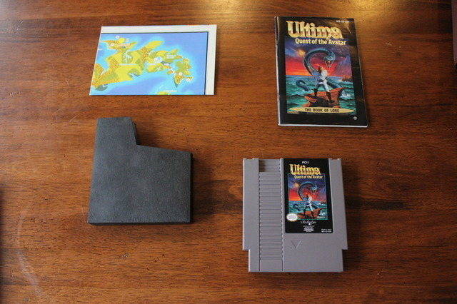 Not only is the case signed, but the game is in COMPLETE condition. You get the cart, the thick manual, and the folded map.