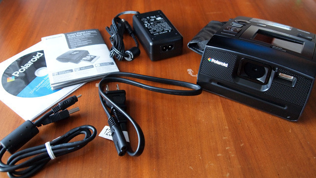 Supplied with the Z340 are a USB cable, bulky AC adapter/charger, and a CD-ROM with software you probably won't use. Also included are a hand strap, rechargeable Li-ion battery, and 10 sheets of Zink paper.